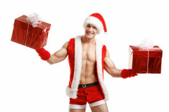 fitness Santa Claus holding a red boxes stock images