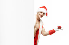 fitness Santa holding a red boxes stock photos