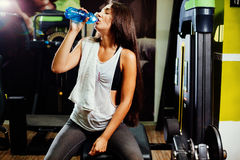 Woman in fitness gym drink water stock image image 61105943 fitness woman drink water in gym stock photography sciox Gallery