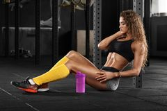 fitness woman in gym, abs. Beautiful muscular girl, shaped abdominal, slim waist royalty free stock photos