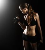 Sexy fitness woman in shorts on black background Stock Photo