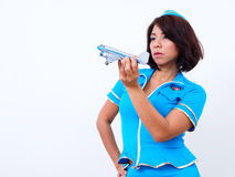 Sexy flight attendant plays with model plane Stock Photography