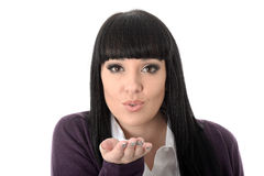 Flirtatious Attractive Gorgeous Woman Blowing Kisses. Flirtatious attractive gorgeous Young Woman, with long black straight hair and hispanic or european stock photo