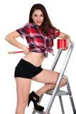 Sexy Frau auf einer Leiter Lizenzfreies Stockfoto