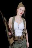 Sexy Frau bei der Militäruniformaufstellung Stockfotos