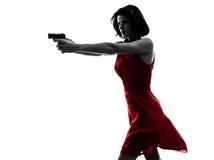 Sexy Frau, die Gewehrschattenbild hält Stockbilder