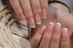 French manicure. On long beautiful nails royalty free stock photos