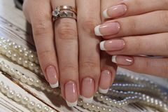 French manicure. On long beautiful nails royalty free stock image