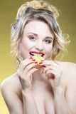 Fruit Series. Portrait of Cute Funny Naked Caucasian Girl. Holding Lemon Slice In Front of Her Mouth. Posing Against Yellow Background. Vertical Image stock photos