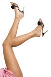 Sexy and funny legs in black shoes Royalty Free Stock Photography
