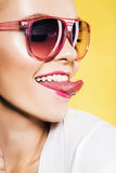 funny woman in sunglasses showing tongue Royalty Free Stock Photography