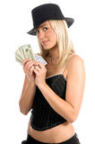 Sexy Gambler. Beautiful and sexy young blonde gangster girl in a pinstripe hat and corsette top with a Hearts Royal Flus and a handful and poker cards Royalty Free Stock Photos
