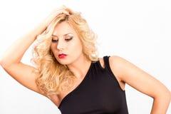 Sexy gelockte Blondine lizenzfreies stockfoto