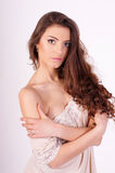 Sexy girl. Portrait of a beautiful young brunette with long hair Royalty Free Stock Photography