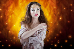 Sexy girl on abstract flame background. glamour skin and make up Royalty Free Stock Images
