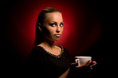 Sexy girl with aggressive makeup and white cup Royalty Free Stock Image