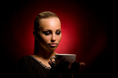 Sexy girl with aggressive makeup and white cup Royalty Free Stock Photography