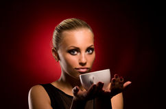 girl with aggressive makeup and white cup Stock Images