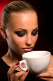 Sexy girl with aggressive makeup and white cup Stock Images