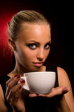 Sexy girl with aggressive makeup and white cup Stock Photography