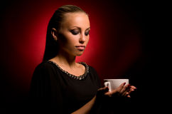 Sexy girl with aggressive makeup and white cup Stock Image