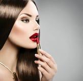 girl applying makeup Royalty Free Stock Photo