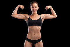 Sexy girl with an athletic body. Isolated on black Royalty Free Stock Photos