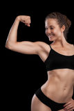 Sexy girl with an athletic body. Isolated on black Stock Photography