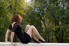 Sexy girl in autumn park Royalty Free Stock Image