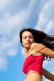 Sexy girl on a background of clouds Royalty Free Stock Images