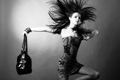 Sexy girl with a bag Royalty Free Stock Image