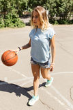 Sexy girl on the basketball court Stock Photo