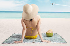 Sexy girl on beach looking at airplane Royalty Free Stock Image