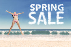 Sexy girl on beach with spring sale text Royalty Free Stock Images
