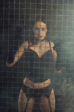Sexy girl behind prison bars Stock Photos
