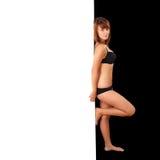 Sexy girl behind  wall Royalty Free Stock Image