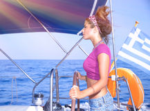 Sexy girl behind yacht helm Royalty Free Stock Photo