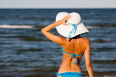 Sexy girl in big hat on the beach Stock Photo