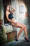 girl in bikini posing fashion near red brick wall on the street Royalty Free Stock Photos