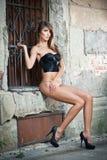 girl in bikini posing fashion near red brick wall on the street Stock Photos