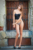 Sexy girl in bikini posing fashion near red brick wall on the street Stock Photo