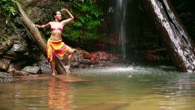Sexy girl with bikini posing in rainforest waterfall stock footage