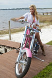 Sexy Girl In Bikini & Shorts on Chopper Motorbike Stock Photo