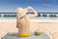 Sexy girl in bikini sitting at beach Royalty Free Stock Image
