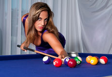 Sexy Girl in the billiard. Young hispanic girls plays pool with a very sexy dress Royalty Free Stock Photo