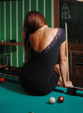 Sexy girl on the billiard-table Stock Images
