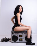 Sexy girl in black body is sitting tape recorder Stock Photos