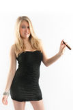 Sexy girl in a black dress, cigar, funny face. Stock Photo