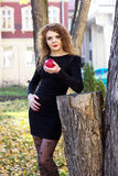 girl in a black dress with red apple. girl in the black dress with red apple Royalty Free Stock Photography
