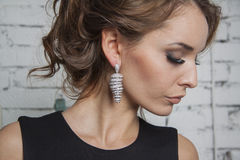 Sexy girl in black gown and luxury earrings Stock Photo